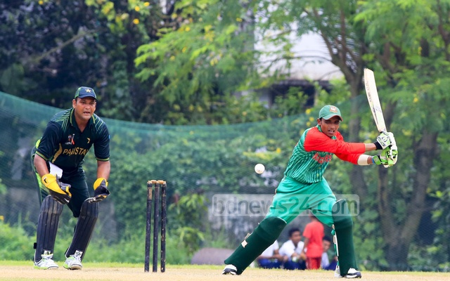 A moment during the match between Pakistan and Bangladesh in the ICRC Twenty20 Cricket Tournament at the BKSP ground No. 3 at Savar. Duckworth-Lewis method came into play as the hosts lost the rain-marred match by 20 runs on Saturday. Photo: mustafiz mamun