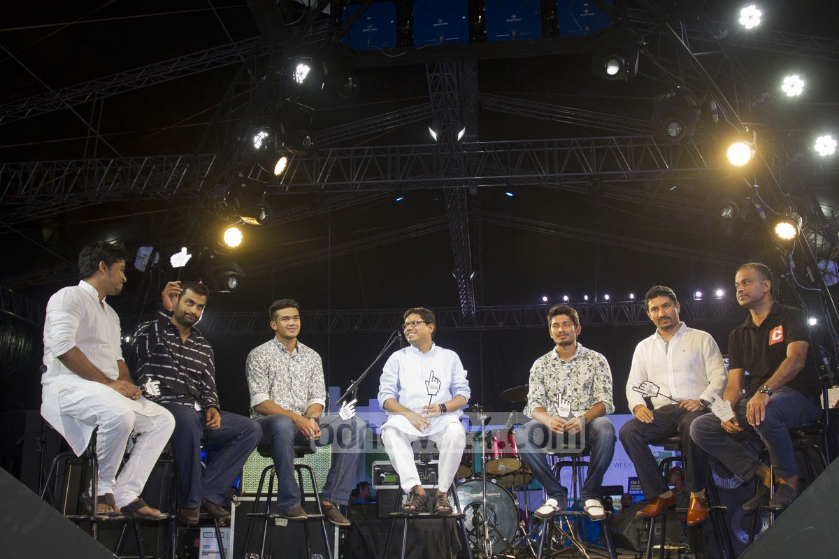 National cricketers Tamim Iqbal, Taskin Ahmed, and Anamul Haque Bijoy with Minister of State for ICT Zunaid Ahmed Palak onstage of a programme at 'Bangladesh Internet Week 2015' fair at Banani in Dhaka on Sunday. Photo: tanvir ahammed