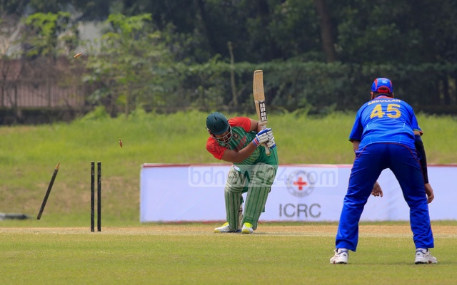 Bangladesh batsman Faisal Khan Shumit is bowled by Afghanistan's Tufail during their match in the ICRC T20 tournament on Monday. Photo: mustafiz mamun