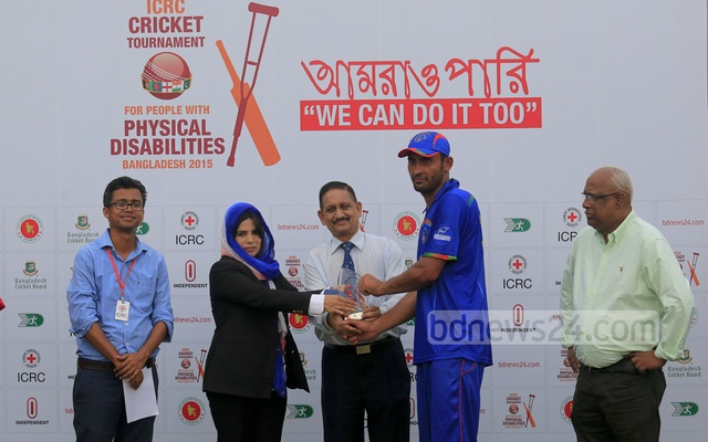 Afghanistan's Mohammadullah takes the Man of the Match award after his side beat Bangladesh in the ICRC T20 tournament on Monday. Photo: mustafiz mamun