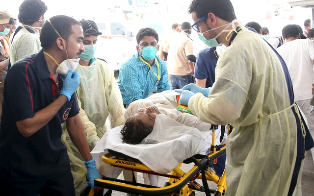 Medical personnel tend to a wounded pilgrim following a crush caused by large numbers of people pushing at Mina Sep 24, 2015. Reuters