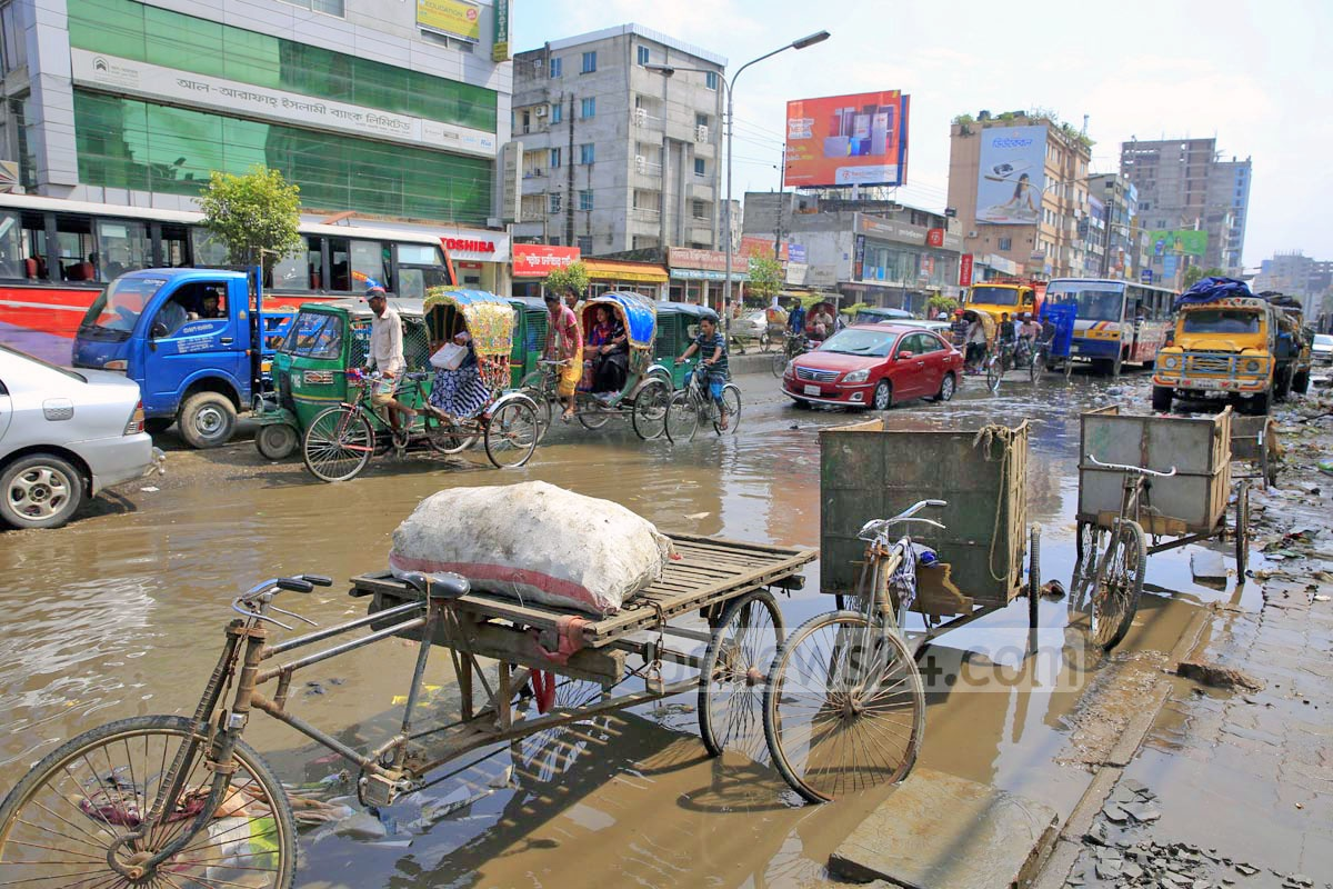 Garbage disposal trolleys of the city corporation occupy a good portion of the road in Dhaka's Badda, causing inconvenience to pedestrians. Photo: mostafigur rahman