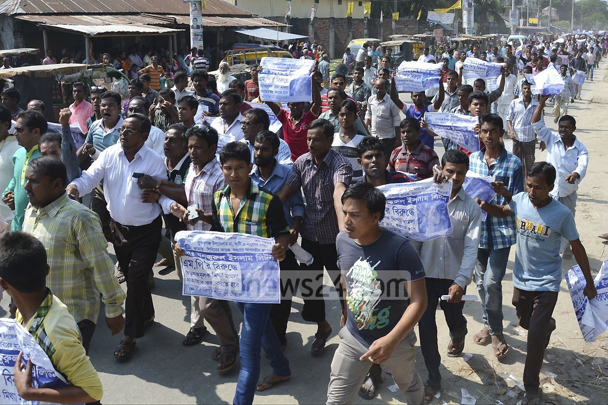 The supporters of MP Manjurul Islam Liton, arrested for firing at a nine-year-old boy, bring out a procession demanding his release during the hearing of his bail petition at a Gaibandha court on Thursday.
