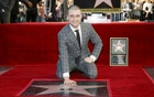 Daniel Radcliffe poses during a ceremony honouring him with a star on the Hollywood Walk of Fame in Hollywood, California, Nov 12, 2015. Reuters