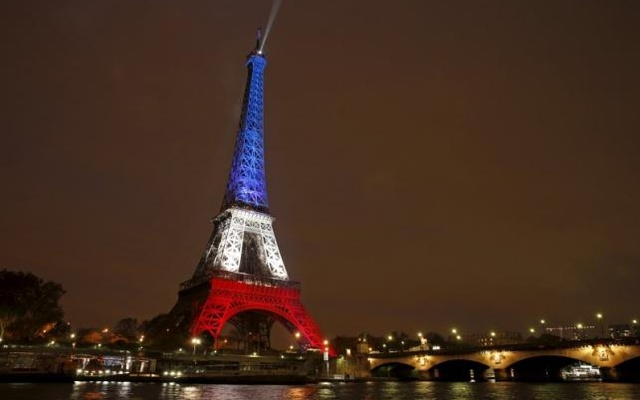 The Eiffel Tower is lit with the blue, white and red colours of the French flag in Paris, France in this November 16, 2015 file photo. Reuters