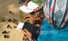 Medical worker at a village in Bangladesh enters maternal and primary healthcare data of a patient in a digital device to track medical records. bdnews24.com file photo