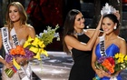 Miss Colombia Ariadna Gutierrez (L) stands by as Miss Universe 2014 Paulina Vega (C) transfers the crown to winner Miss Philippines Pia Alonzo Wurtzbach during the 2015 Miss Universe Pageant in Las Vegas, Nevada, Dec 20, 2015. Reuters