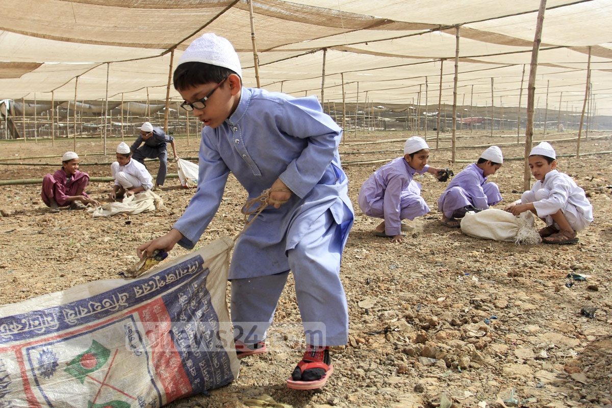 Madrasa students work at the Bishwa Ijtema ground at Gazipur's Tongi.