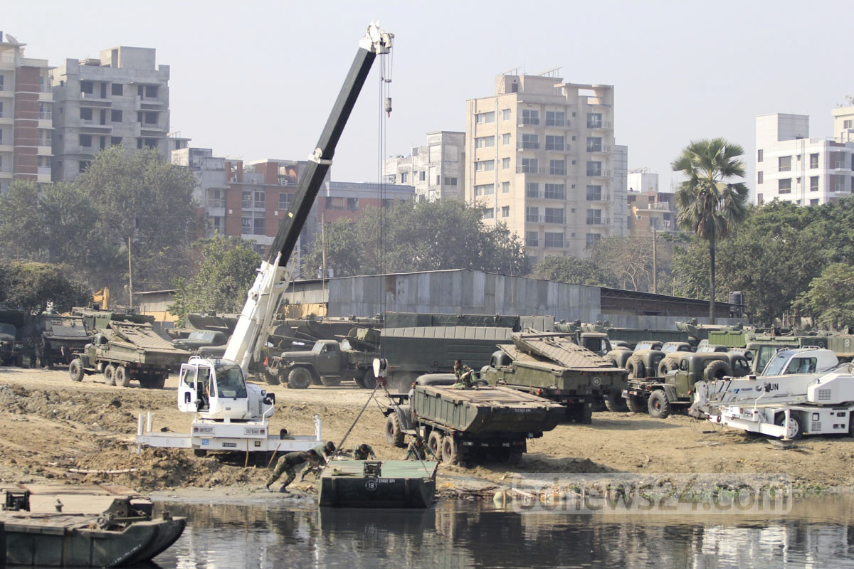 Army personnel prepare a floating bridge on the Turag river beside the Bishwa Ijtema ground at Gazipur's Tongi.