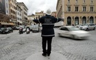 A policeman gestures as he directs traffic in downtown Rome,Jan 24, 2014. Reuters