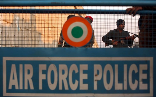 Security personnel stand guard next to a barricade outside the Indian Air Force (IAF) base at Pathankot in Punjab, India, Jan 2, 2016. Reuters