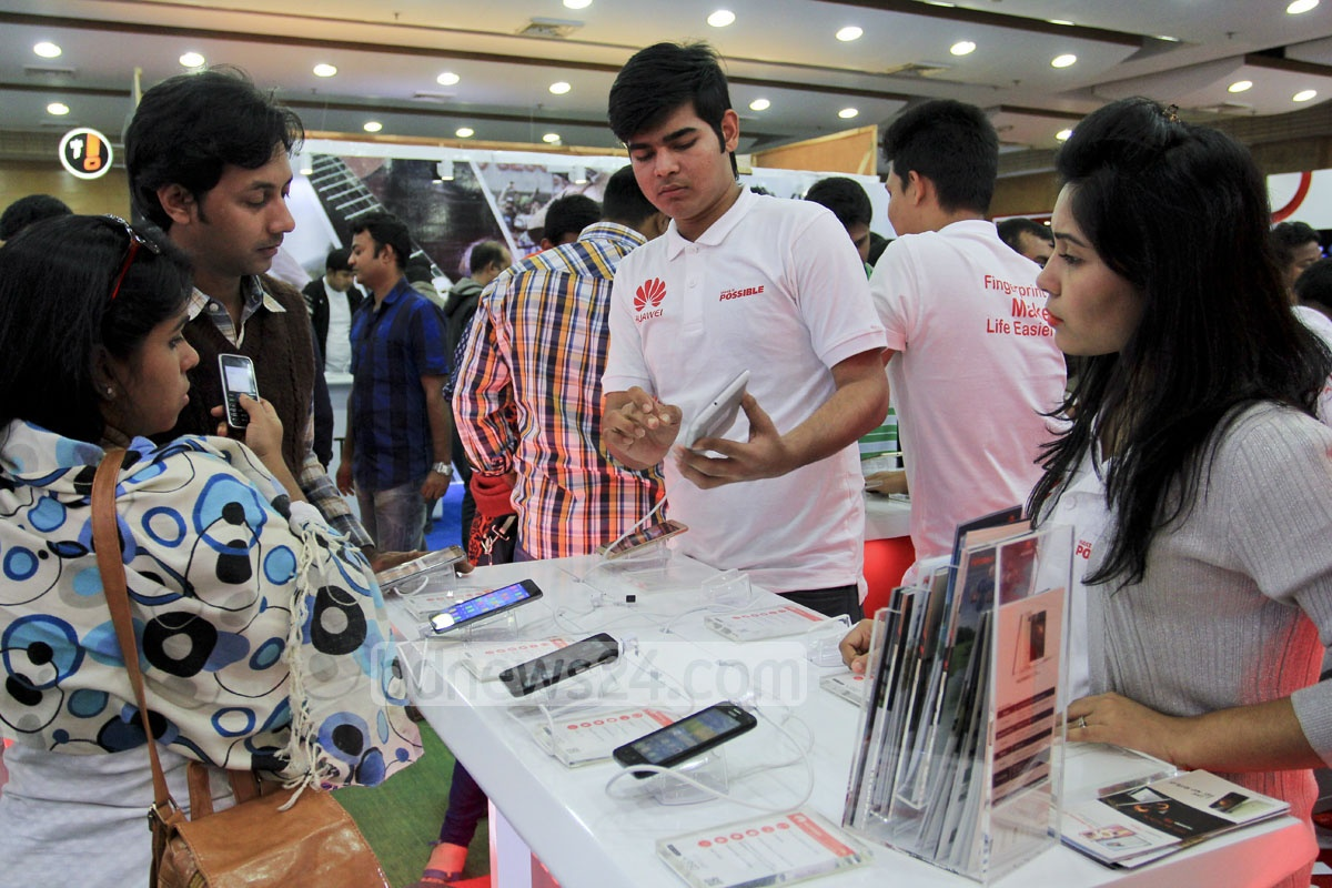 Visitors check about products at the three-day smart phone and tab exposition beginning at Bangabandhu International Conference Centre in Dhaka on Thursday.