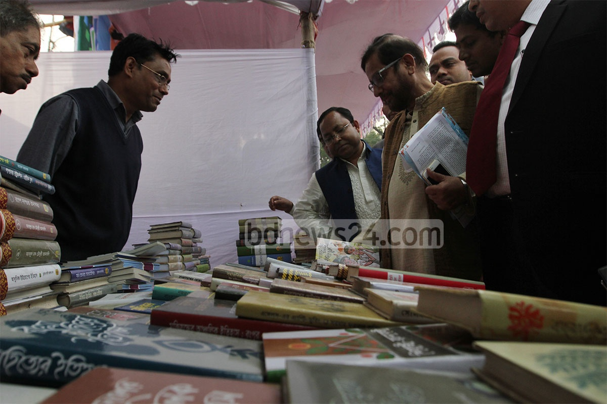 Culture Minister Asaduzzaman Nur goes around the book fair being held on a ground next to Chittagong's M A Aziz Stadium after its inauguration on Wednesday.