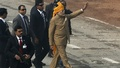 India's Prime Minister Narendra Modi (wearing turban) waves to the crowd after attending the Republic Day parade in New Delhi, India, January 26, 2016. reuters