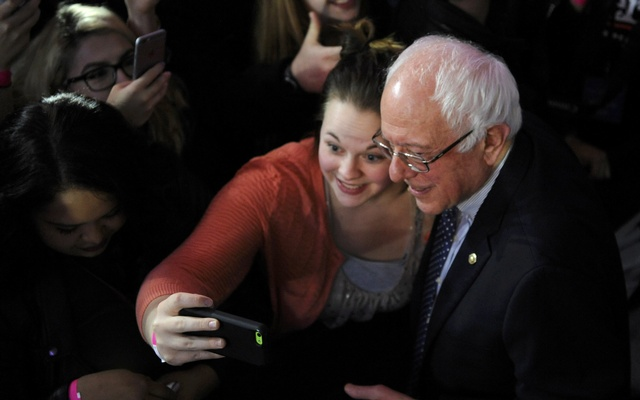 US Democratic presidential candidate Bernie Sanders poses for a selfie with a supporter during his caucus night rally in Des Moines, Iowa February 1, 2016. reuters