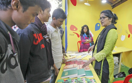 Visitors at the stall of the bdnews24.com Publishing Limited at the book fair in the Bangla Academy complex on Thursday. Photo: nayan kumar