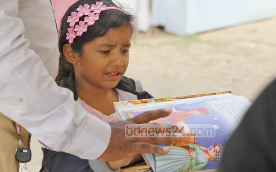 A child reacts after failing to find the books of her choice at the Amar Ekushey Book Fair on Sunday. Photo: nayan kumar