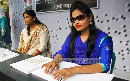 Vision-impaired salesgirls at a stall of Braille books at the Amar Ekushey Book Fair on Sunday. Photo: nayan kumar