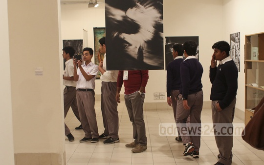 Visitors at the Dhaka Art Summit on Monday. The exhibition was held at the Shilpakala Academy. Photo: abdul mannan