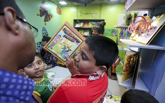 A child pleading with his guardian to buy him a book at Amar Ekushey Book Fair on Friday. Photo: asaduzzaman pramanik