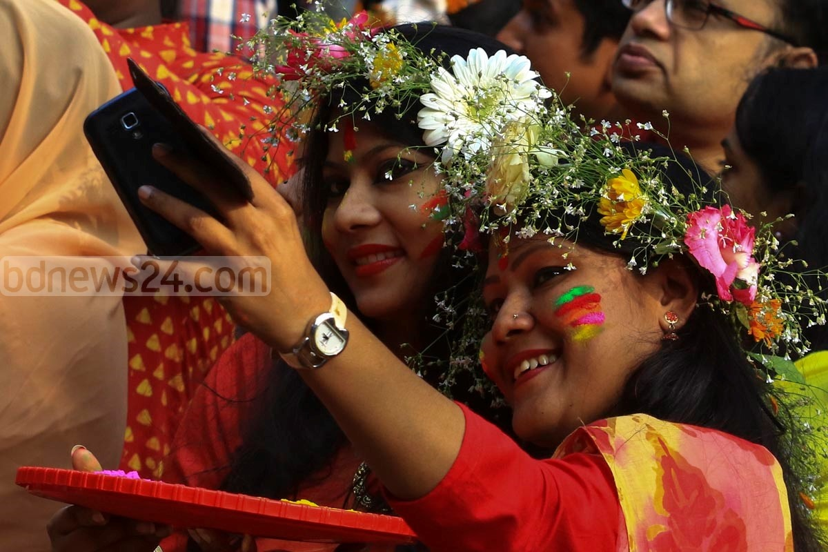Young girls taking selfie at 'Spring festival'. The picture was taken at Dhaka University's Faculty of Fine Arts. Photo: mostafigur rahman