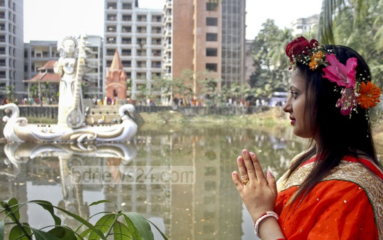 A devotee worships in front of an image of goddess Saraswati at Dhaka University's Jagannath Hall on Saturday.