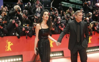 Cast member George Clooney and his wife Amal arrive on the red carpet for the screening of the movie 'Hail, Caesar!', during the opening gala of the 66th Berlinale International Film Festival, in Berlin, Germany February 11, 2016. Reuters