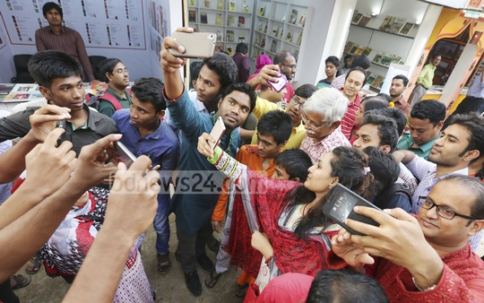 People busy taking selfies with their favourite writer Zafar Iqbal at the book fair on Sunday. Photo: asaduzzaman pramanik