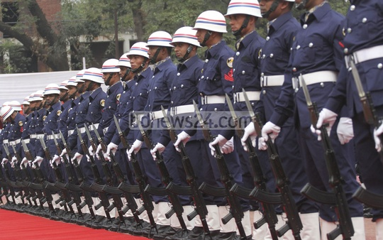 Coast guards march during a ceremony marking its 20th founding anniversary on Sunday. Photo: tanvir ahammed