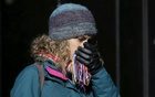 A woman is seen bundled up from the cold in New York Feb 12, 2016. Reuters