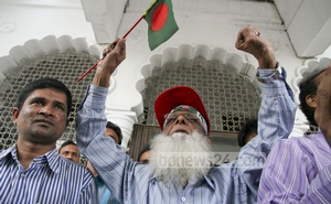 Freedom fighters at the court premises celebrate after Mir Quasem's death sentence is upheld.