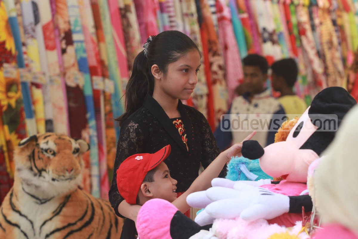 Children crowd around a stall at Chittagong International Trade Fair on Friday.
