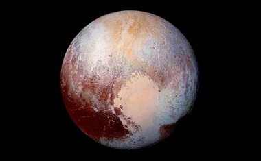 This NASA's photo of Pluto was made from four images from New Horizons' Long Range Reconnaissance Imager (LORRI) combined with color data from the Ralph instrument in this enhanced color global view released on July 24, 2015. The images, taken when the spacecraft was 280,000... Reuters