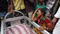 A woman mourns next to the body of Mohammad Ramzani, a cycle rickshaw driver who died after an under-construction flyover collapsed on Thursday, in Kolkata, April 1, 2016. reuters