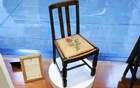 A chair used by British author J.K. Rowling while writing 'Harry Potter and the Sorcerer's Stone' and 'Harry Potter and the Chamber of Secrets' is shown in the window of Heritage Auctions in New York April 4, 2016. Reuters
