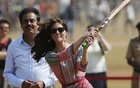Britain's Catherine, Duchess of Cambridge, plays cricket with children at a ground in Mumbai, India, April 10, 2016. reuters