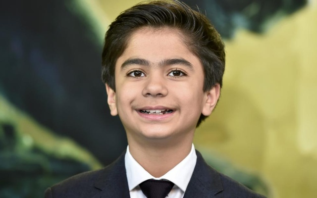 Actor Neel Sethi poses for photographers as he arrives at the British premiere of the film