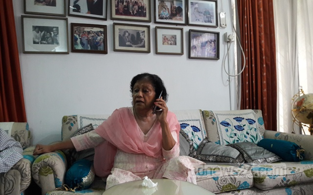 A worried Taleya Rehman making calls to find out her husband's whereabouts. Photo: Shahidul Islam