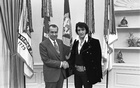 President Nixon shakes hands with Elvis Presley in the Oval Office in Washington, DC in December 1970 after the little-known meeting. Reuters