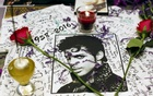 A makeshift memorial is seen as fans gather at Harlem's Apollo Theater to celebrate the life of deceased musician Prince in the Manhattan borough of New York, US, April 21, 2016. Reuters