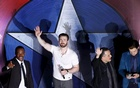 Actors Anthony Mackie, Chris Evans, director Joe Russo and actor Sebastian Stan (L-R) wave to fans during a blue carpet event for the movie ''Captain America: Civil War'' in Singapore, April 21, 2016. Reuters
