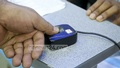A user provides fingerprint to get his SIM card re-registered at Farmgate on Friday. Photo: abdul mannan