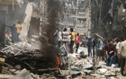 People inspect the damage at a site hit by airstrikes, in the rebel-held area of Aleppo's Bustan al-Qasr, Syria April 28, 2016. Reuters