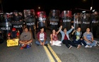 Demonstrators sit in front of a line of police in riot gear outside Republican U.S. presidential candidate Donald Trump's campaign rally in Costa Mesa, California April 28, 2016. Reuters