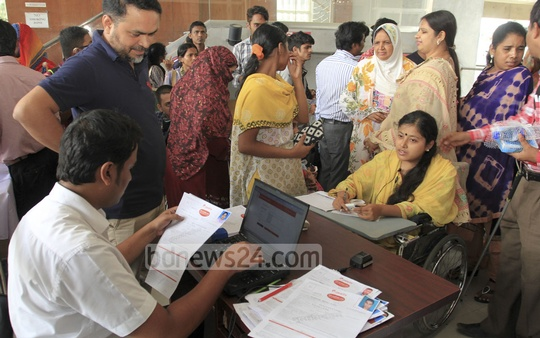 AMTOB organises biometric re-registration of mobile phone SIM cards for differently-abled persons at the auditorium of Krishibid Institution in the capital on Saturday.