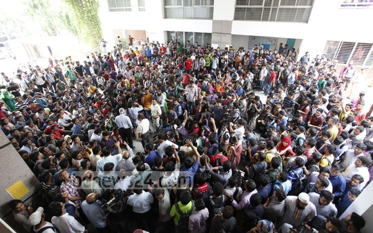 Students demonstrate in front of Ahsanullah University of Science and Technology's Tejgaon campus on Saturday demanding punishment for a teacher accused of sexual harassment. In the face of students stir university authorities later suspended the teacher. Photo: nayan kumar