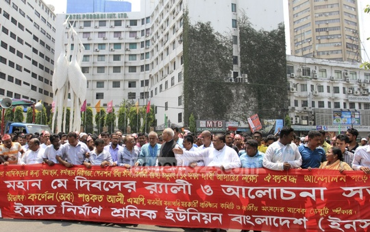 Construction workers walk in a precession in Dhaka on May Day, demanding housing and safety at workplaces.