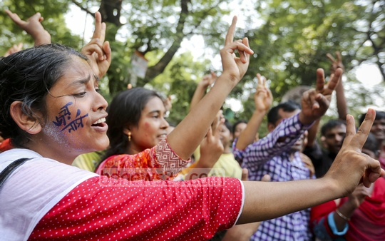 Nurses agitating for appointment on the basis of seniority rejoice in front of the National Press Club in Dhaka on Sunday over the government's assurance to meet their demand. Photo: asaduzzaman pramanik