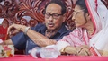 Jatiya Party Chairman HM Ershad and his wife Senior Co-chairman Raushon Ershad speak at the party's May Day programme at its office in Kakrail on Sunday after a power struggle between them became public.