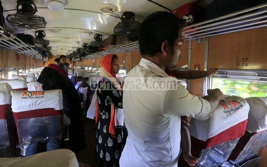 Despite increase in fares, rail service has hardly improved. Passengers crowd compartments in Inter-city Dhaka-Sylhet Kalni Express .
